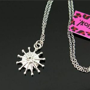 Silver and Crystal sun or snowflake chain necklace
